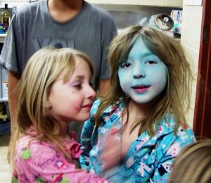 Deranged Tinkerbelle had to get closer and then started comparing her sisters pajama's to her face.  Yep Amethyst, Sierra's face is the same color as her shirt.  I remember a few pieces of make-up advice from the 80's.  One being try to match your make-up with your clothing in a descret way.  HA HA HA HA This is not descret.  Question is:  Smurf or is she Veruca Salt?