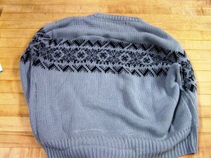 first pick your sweater out and sew a circle in the middle.  Remember to leave an opening to stuff the circle. You c an use stuffing, batting, an old pillow or fabric pieces.
