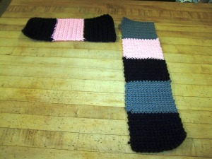 I have no clue on sizes on these, it is going to be pretty much trial and error. I have boats for feet, size 11 in women's and these fit me fine.  I did 4 inch by 4 inch double crochet squares. Two strips, one with 5 and one with 3 squares. I picked for you contrasting colors and horrid stitching so you could see what I was doing. Once you have your 2 strips get ready to slip stitch.