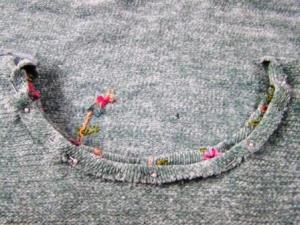Fold over a half inch hem and stitch.