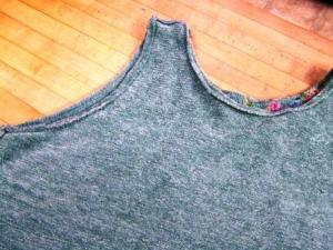 You should now have both sleeves and neckline stitched.  Run a double stitch along the bottom waistband of the sweater from one side to the other.  Turn the sweater right side out.