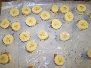 Next is to pull from the freezer and spread a little bit of peanut butter between 2 layers of banana slices. Pop back in the freezer for an hour.