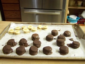 Last, take peanut butter banana sandwiches from the freezer and roll until covered completely, in tempered chocolate. Let chocolate set until firm. Don't worry it only takes a minute for the chocolate to set and then you can start popping the Monkey Bites in your mouth.  Whatever is left, you should store in a sealed bag or air tight container. We store ours in the freezer and will keep for up to 6 months.