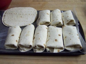 Lay out your tortilla shells and fill, then roll closed. Put on a platter or tray, it goes into the freezer for an hour or so. Transfer into a sealed bag or container to store in the freezer. When needed heat in microwave for 2 minutes and 3 minutes for 2 at a time.