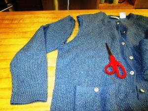 Take your old sweater and cut off both sleeves. The sleeves will be yur socks.