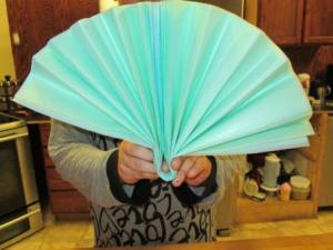 Ah the glory days, the paper fan. When you are don folding, fold your paper in half to find your middle.