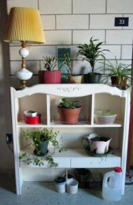 As you can see it holds quite a few plants and would also be easy to move outside for the summer months.